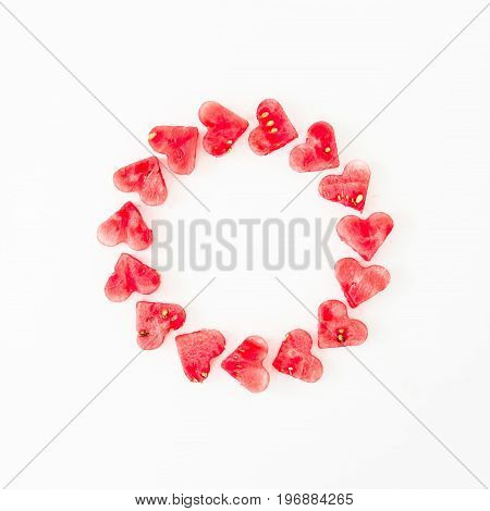 Water melon cut into heart shape. Flat lay round composition on white background. Top view