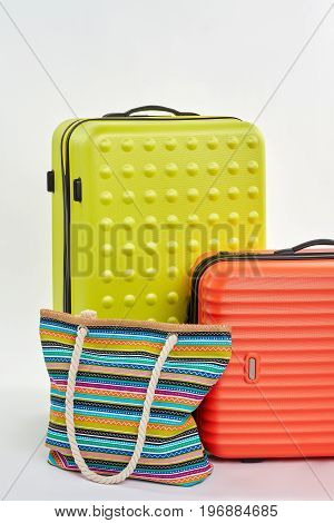 Colorful suitcases for summer your. Vertical image of bag on wheels, textile handbag.