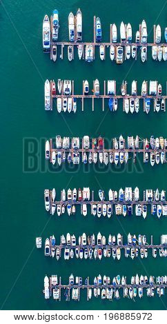 Pier speedboat. A marina lot. This is usually the most popular tourist attractions on the beach.Yacht and sailboat is moored at the quay.Aerial view by drone.Top view.