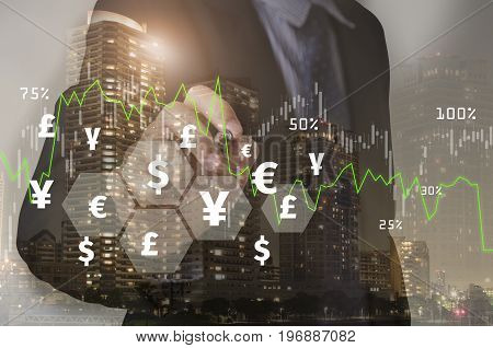 Double exposure businessman writing financial analysis graph with signs money. concept exchange currency.