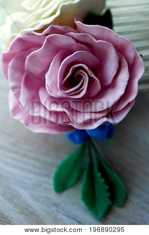 Hair decoration of flowers made of artificial suede. a delicate accessory