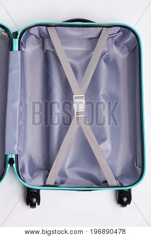 Modern empty case for travelling. Single open bag on wheels for tourist .