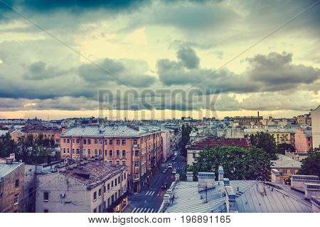 View from roof, Old town or downtown of St. Petersburg at sunset in cloudy day, toned