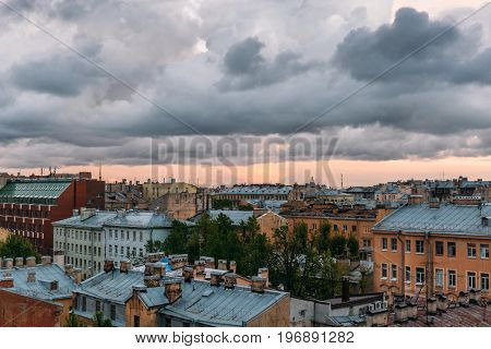 Saint Petersburg view from roof top. St. Petersburg cityscape, dramatic clouds, old buildings, famous tourist place, toned