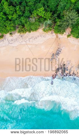 Sea aerial viewTop viewamazing nature background.The color of the water and beautifully bright.Azure beach with rocky mountains and clear water of Thailand ocean at sunny day.