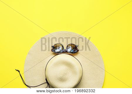 Straw Beach Woman's Hat Top View Yellow Background
