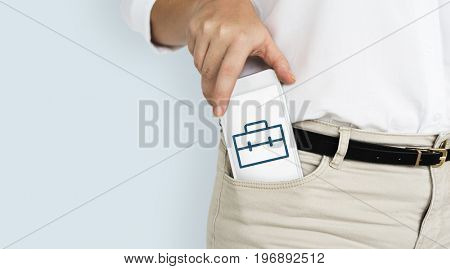 Hands holding network graphic overlay digital device from trouser pocket