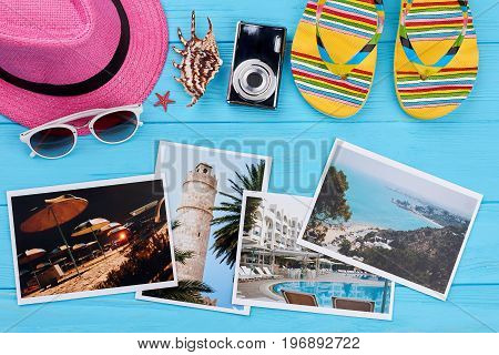 Women beach accessories above photos. Stuff for sea, photos of resorts, blue background. Choose the place of vacation.