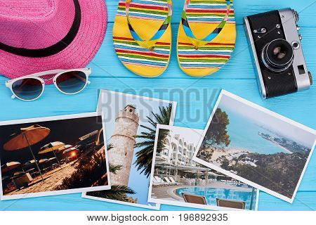 Close up of beach accessories. Holiday pictures, summer accessories, wooden background.