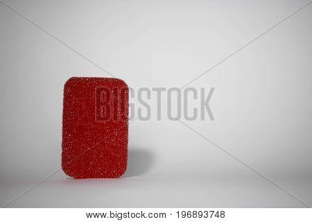 Red sponge sponge on white background For advertising