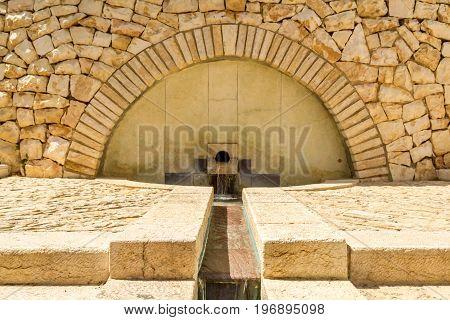 Water flowing down the stone steps. Cascade fountainin Teddy Park in Jerusalem Israel