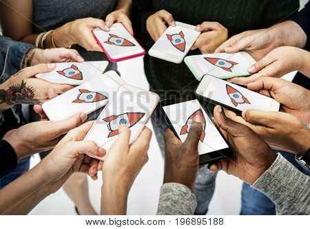 Group of people using smart phone with spaceship icon on the screen