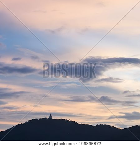Sunset Behind Big Buddha Statue On Mountain Phuket