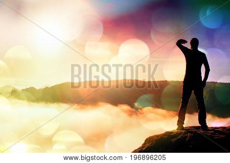 Film Grain. Funny Boy On The Sharp Peak Of Rock In Rock Empires Park Is Watching Over The Misty And