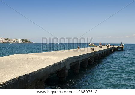 pier with blue sea and sky background
