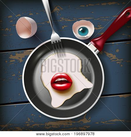 cracked raw egg with red lips and eye on frying pan with fork on the old wood table