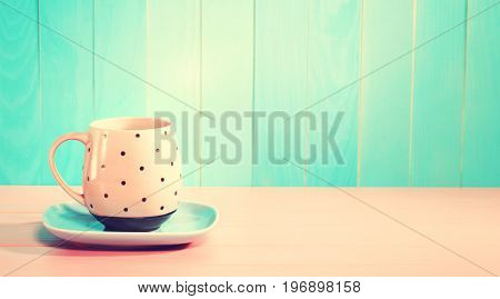 Coffee mug on a bright pastel pink and blue background