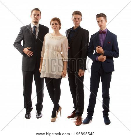Four well-dressed young adults standing together on white background.