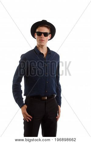 A young man wearing a shirt, fedora and sunglasses