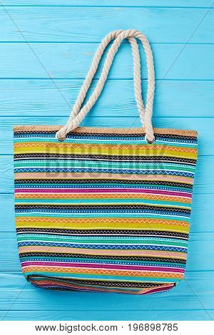 Summer beach bag with stripes. Female bag for personal accessories.