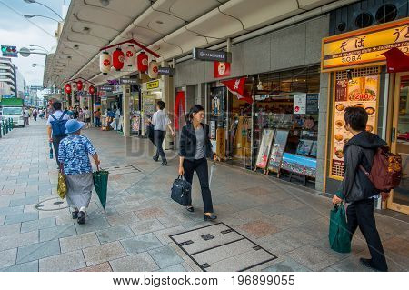 KYOTO, JAPAN - JULY 05, 2017: Unidentified people walking in the streets on Gion District, located in the center of Kyoto city.