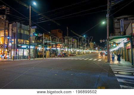 KYOTO, JAPAN - JULY 05, 2017: Night scene of tourists wondering around the narrow street of Gion DIstrict, Kyoto, Japan.