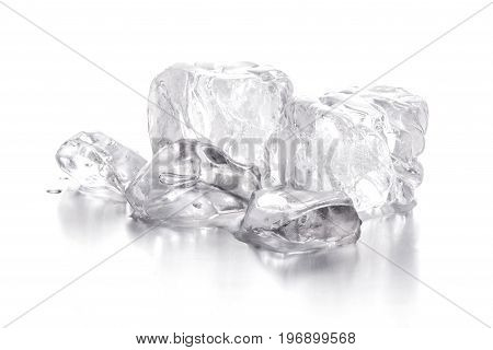 Few slices of ice on a white background with drops of water