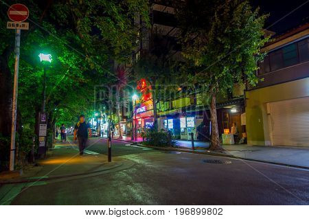 KYOTO, JAPAN - JULY 05, 2017: Unidentified people walking at night scene of tourists around the narrow street of Gion DIstrict, Kyoto.