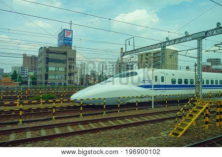 KYOTO, JAPAN - JULY 05, 2017: JR700 shinkansen bullet train departing Kyoto station shown on August 12, 2015 in Kyoto, Japan.