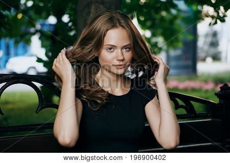 Young beautiful woman is walking outdoors in the city.