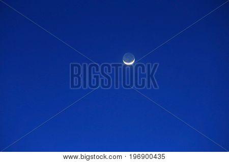 Half-moon in blue sky