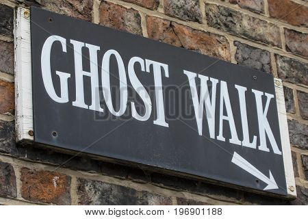 A sign for a Ghost Walk in the historic and haunted city of York in England.