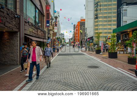 HAKONE, JAPAN - JULY 02, 2017: Unidentified people walking at street. It also provides bus stop for Hakone Tozan Bus back to Hakone-Yumoto and Odawara.