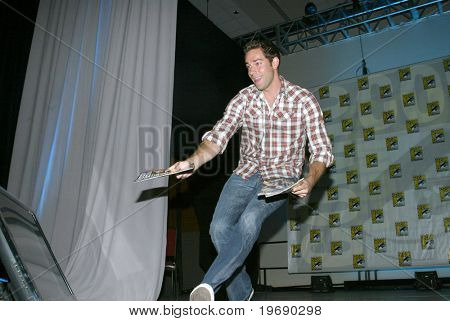 SAN DIEGO, CA - JULY 23: Actor Zachary Levi hands out special edition TV Guides after the TV Guide panel on July 23, 2010 at the 2010 Comic Con International held in San Diego, CA.