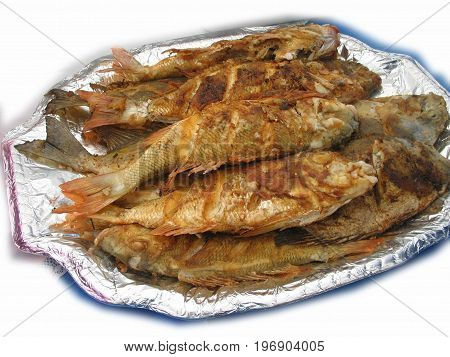 Fried fish piled on top of a platter with aluminum foil Fried fish is an all time favorite viand in the Philippines and southeast asian countries. It is usually eaten with soy sauce and vinegar dipping