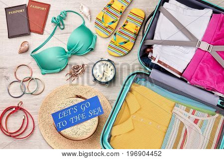 Summer vacation background, grey surface. Family resort abroad with beautiful accessories.