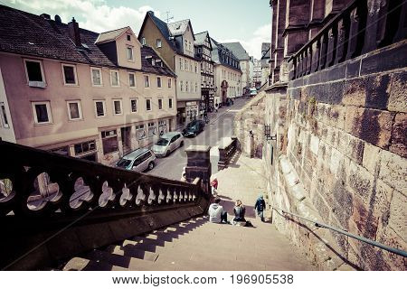 MARBURG GERMANY - APRIL 18 2015: Historic streets of the old quarters of Marburg. Toning. Stylization. Marburg is a university town in the German federal state (Bundesland) of Hessen.