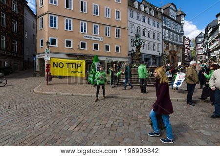 MARBURG GERMANY - APRIL 18 2015: Protest Greenpeace activists in the historic center of the city against the Transatlantic Trade and Investment Partnership (TTIP).