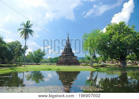 Sunny day at Sukhothai Historical Park,  World heritage site. One of the most famous places in Thailand.