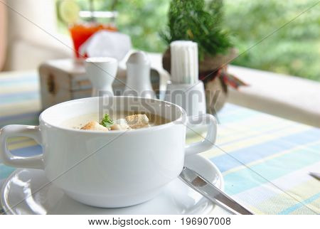 A cup of Soup on the Table