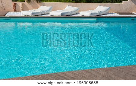 comfortable mattresses to rest in the pool with turquoise water