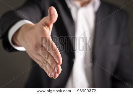 Business man offer and give hand for handshake. Salesman or real estate agent shake for deal, agreement or sale. Partnership, recruitment, acquisition and cooperation concept.