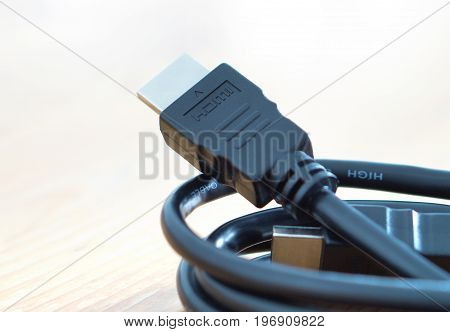 HDMI cable on wooden table at home.