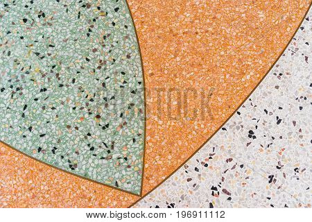 Terazzo Floor background. Terrazzo is a composite material, poured in place or precast, which is used for floor and wall treatments. It consists of chips of marble, quartz, granite, glass, or other suitable material, poured with a cementitious binder (for