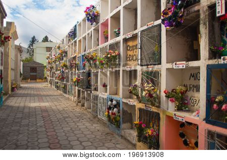 QUITO, ECUADOR- MAY 23, 2017: View of cemetery San Antonio de Pichincha, showing typical catholic graves with a burial vaults.