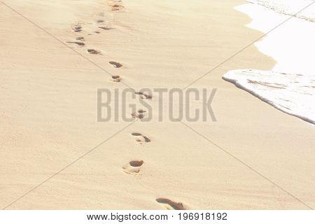 Human footprints on beach sand at resort