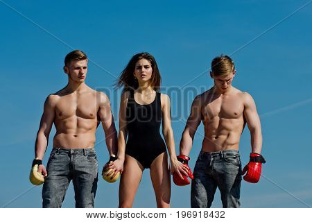 Woman And Twins With Muscular Body.