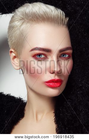 Young beautiful platinum blond glamorous woman with red mascara and lipstick