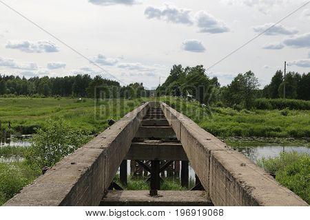 Old abandoned railway bridge over the river.