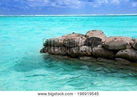 Stone breakwater at sea resort on summer day